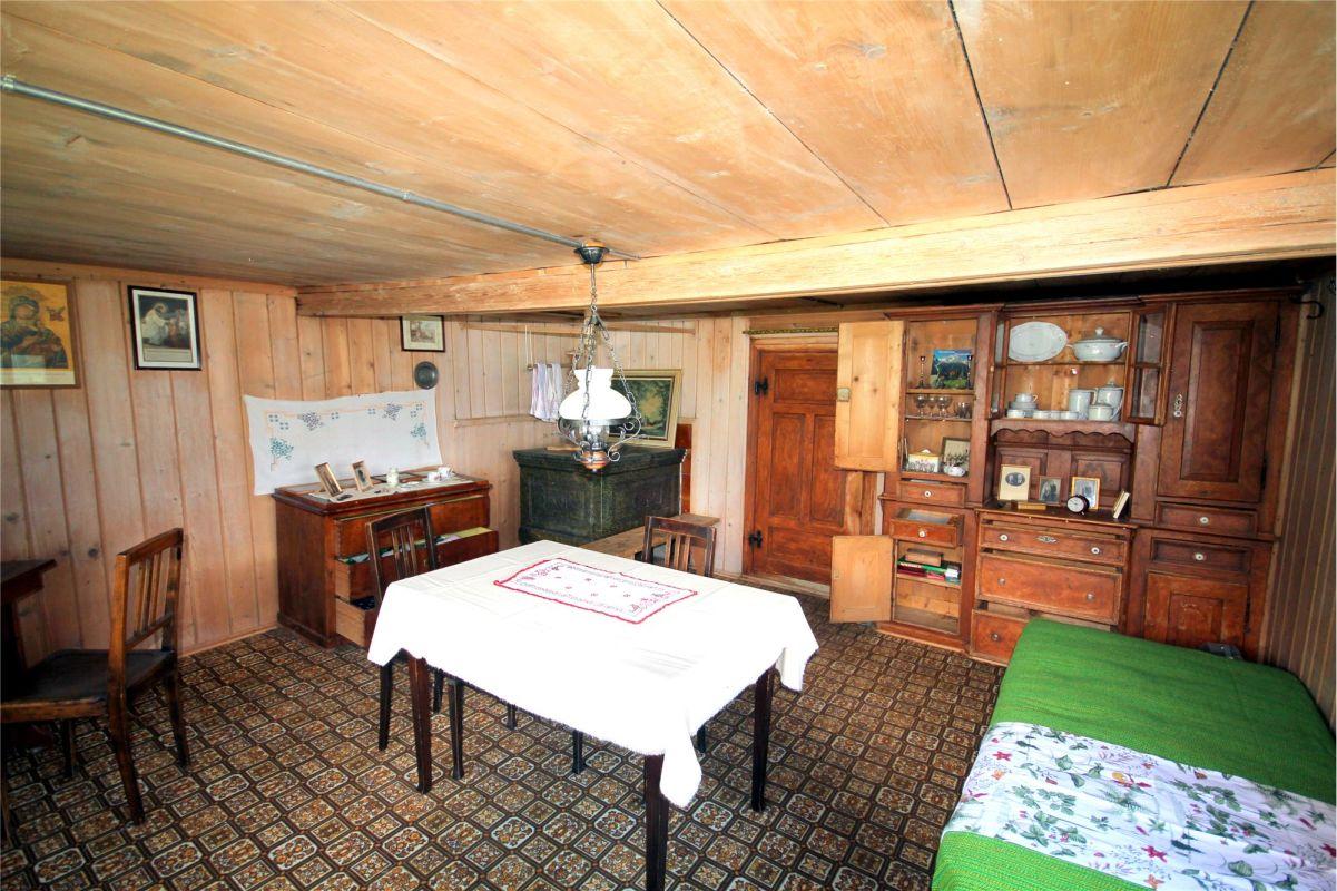 Wohnzimmer/Stube mit Kachelofen